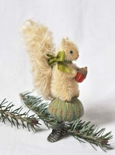 "Sidney the Squirrel brings a gift a little less than 6"" tall, fabric: mohair and 100% wool felt onyx eyes, acorn top, vintage clip, embroidery floss stitches and details. Stuffed with excelsior (wood shavings) Hand Dyed and Aged One of a kind - Hand Made by Jennifer Murphy - 2011"