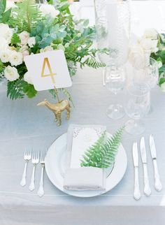 Gold and greenery wedding table decor: http://www.stylemepretty.com/2017/01/10/a-dreamy-destination-wedding-that-walks-on-the-wild-side/ Photography: Elizabeth Messina - http://www.elizabethmessina.com/#!/images/love/gallery/1