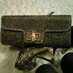 Reach for the silver,  gray, clutch! A pretty, perfect,  clutch closes with a bamboo hardware.  Cushy gift for your hard to  gift relative, or friends.  They will love it! Vivian ' Closet!  Bags Clutches & Wristlets