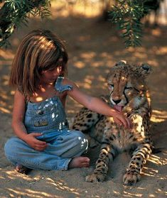 Tippi Degree - Adorable French girl growing up in Africa with wildlife photographer parents. Read her story here http://www.livehonestly.com/28/post/2011/1/tippi-degre-adorable-french-girl-growing-up-in-africa-with-wildlife-photographer-parents.html#