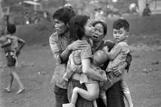 South Vietnamese civilians, among the few survivors of two days of heavy fighting, huddle together in the aftermath of an attack by government troops to retake the post at Dong Xoai. Horst Faas - 1965 Photo Contest | World Press Photo