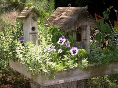 From Flea Market Gardening on FB.  Joy placed a wooden platform planted with flowers on this stump and set a couple very cute and rustic birdhouses on top.