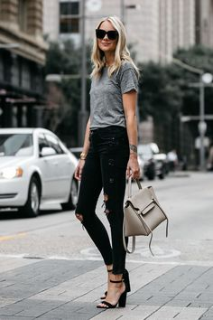 0e43cadc87 Blonde woman wearing Madewell grey tshirt zara black ripped skinny jeans  outfit steve madden black ankle