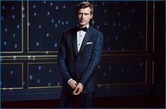 BOSS reunites with Clément Chabernaud for its holiday 2016 campaign. The French model sports a blue tuxedo for the occasion.