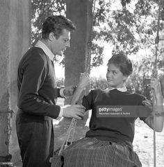 Italian actress Claudia Cardinale swinging on a swing beside Italian actor Marcello Mastroianni in the film Il bell��€™Antonio. 1959