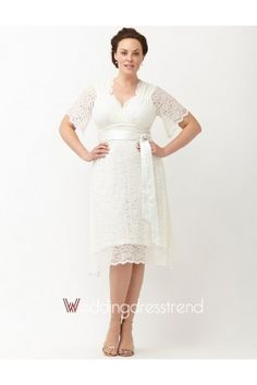 Full backed, lace sleeved tea-length dress