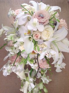 Cascading bridal bouquet with orchids