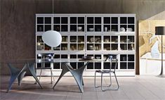 molteni&c· home.6 | | · 11-Piroscafo  Bookcase Aldo Rossi, Luca Meda Arc  Table Foster + Partners  D.235.1  Chairs Gio Ponti
