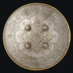 A FINE GOLD AND SILVER-DAMASCENED SHIELD QAJAR IRAN, 19TH CENTURY