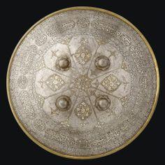 A FINE GOLD AND SILVER-DAMASCENED SHIELD QAJAR IRAN, 19TH CENTURY