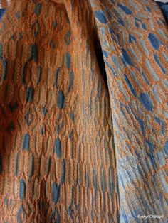 Woven shibori, partly discharged by Evelyn Oldroyd.