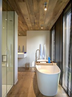Rustic wood ceiling with tub.