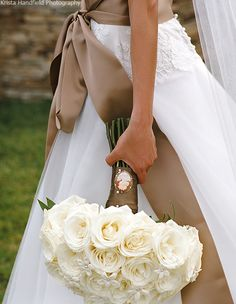 "Classic white rose and stephanotis bridal bouquet finished with a cameo detail...perfect for your ""something old!"""