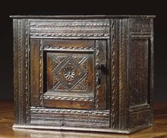 A MURAL CUPBOARD, CHARLES I, SECOND QUARTER 17TH CENTURY carved oak, the door with pin hinges, restorations Medieval Furniture, Antique Furniture, Antique Wooden Boxes, Cottage Decorating, Pilgrim, 17th Century, Cupboard, Art Decor, Period