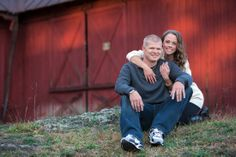 A couple sitting near an old red barn. Copyright Photographics Solution 2013