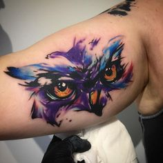 Watwrcolor owl tattoo on arm