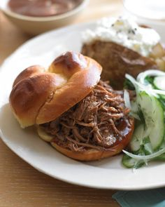 Southern Pulled-Pork Sandwiches... pork shoulder, a well-marbled cut available at most supermarkets, turns fork-tender after long, slow cooking. Ours is especially succulent with a spice rub and vinegar.