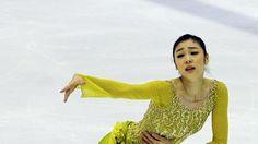 South Korean figure skater Kim Yuna performs at the Korea Figure Skating Championships 2014 in Goyang