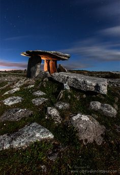 This dramatic site of the Poulnabrone Dolmen sits on the karstic limestone pavement of the Burren and is one of the most famous of Irish dolmens. Images Of Ireland, County Clare, Statues, Republic Of Ireland, Emerald Isle, Ireland Travel, England, Beautiful Landscapes, Places To See