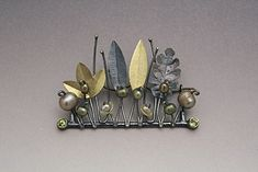 Brooch | Lydia Gerbig-Fast. 'House of the Faun'.  14 & 18k gold, sterling silver, enamel, fresh water pearls and peridot.