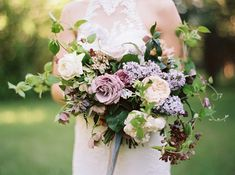 Purple inspired bridal bouquet. #weddingflowers #lilac #lavender