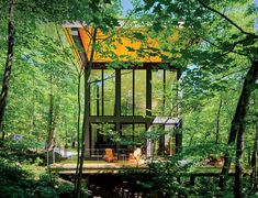 A cantilevered cabin designed by R D Gentzler blends into the Massachusetts mountains, even as it hovers above a 20-foot drop-off. Its south face is almost entirely glass, but a roof canopy limits solar gain.