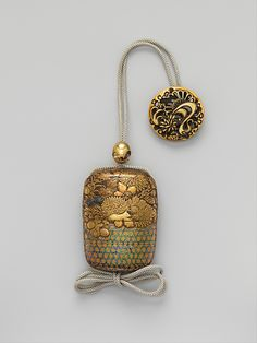 Case (Inrô) with Chrysanthemum Decoration  Period: Edo period (1615–1868) Date: 18th–19th century Culture: Japan Medium: Gold and silver maki-e with inlay of mother-of-pearl on lacquered ground
