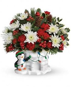 Deck the Halls  This frosty fellow will warm anyone's heart! He's so proud of his festive lights and bountiful bouquet, bursting with the classic colors of the season and delivered in a ceramic keepsake that'll be a Christmas favorite for years to come!