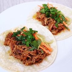 Another tasty recipe from #nytcooking! Vietnamese slow cooker pork tacos topped with  pickled carrots & cucumbers cilantro and mint. by hawaiikim