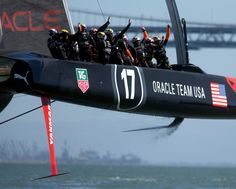 Oracle Team USA sailors celebrate their victory over Emirates Team New Zealand in race 17 of the 34th America's Cup, Tuesday, Sept. 24, 2013...