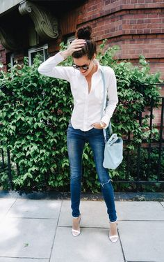 Keeping it simple in a white button down and jeans.