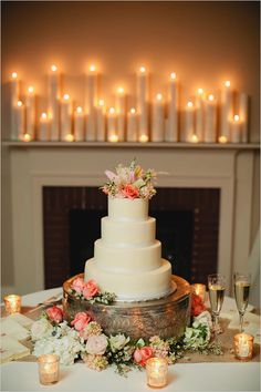 I love all the candles surrounding the cake. Photo by Kristyn Hogan #cedarwoodweddings