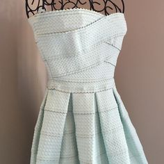 Mint Bandage Dress Beautiful, never worn, mint bandage dress! Strapless style. Zipper in back. Dress hangers still attached. It has bandage like material, so the dress is fairly heavy when on. No trades or Paypal. Lowball offers will be rejected. June & Ivy Dresses Strapless