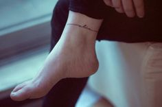 Anklet writing tattoo