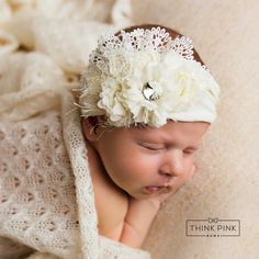 An elegant look for your baby or toddler our vintage inspired headband offers a soft bouquet of flowers in different shapes and textures, embellished with French lace, fancy doily's and crystals.  It is finished off with a comfy elastic nylon headband that won't leave a mark on her sweet head. Shop unique newborn headbands at http://thinkpinkbows.com/products/pillow-talk-headband-ivory |  Shabby Chic | Baptism | Christmas