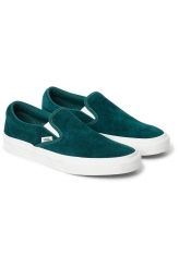 The V Slipon Bayberry Green Sneakers fromVans features a low profile slip-on silhouette with Scotchgard®-treated suede uppers, padded collars, elastic side accents, and Vans signature waffle outsoles.