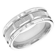 From TRITON, this 8mm grey tungsten carbide band features a comfort fit style and bright cut designs. All TRITON tungsten carbide bands contain a patented TC.850 formula for a scratch resistant forever polished luster. Available in men's and women's sizes.