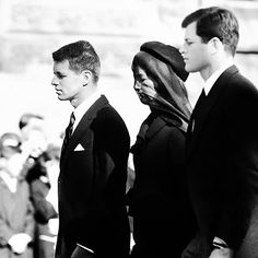 Robert, Jacqueline and Edward Kennedy walk behind the casket of President John F. Kennedy