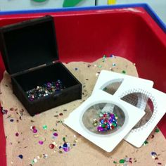 """Treasure hunt in the sand tray - I like the simple sifters ("""",)"""