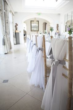 Chair sashes are a beautiful addition to any event. From simple to elegant, a chair sash can complete a look. Check out our favorite looks here! Wedding Chair Sashes, Wedding Table Seating, Wedding Chair Decorations, Wedding Chairs, Wedding Centerpieces, Wedding Chair Covers, Wedding Tables, White Chair Covers, Seat Covers