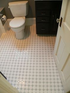 Two-inch white hex tiles with gray diamond insets shine on the floor. Like the gray and white