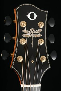 http://olsonguitars.com/the-art/photo-gallery/