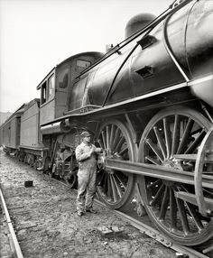 Michigan Central Railroad engineer oiling the squeaky wheels. - 1904