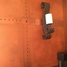 This fabulous wall finish is by Chicago-based Jittaun Priest of Something Creative by JT. She created a metallic wall with bronze studs using our Metallic Paint Collection for this stunning look!