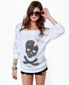 cute beaded skull and crossbones sweater w/a cuff sleeve.