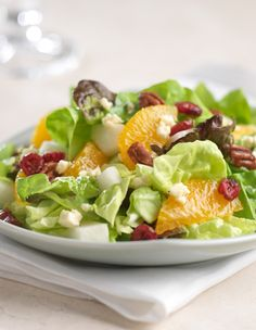 Fresh Express Tangerine Salad with Feta Vinaigrette. Seedless tangerines team up with our tender butter lettuce, dried cranberries, jicama & pecans with a tangy feta vinaigrette for a fresh flavored spring salad. #saladswap #FreshExpress