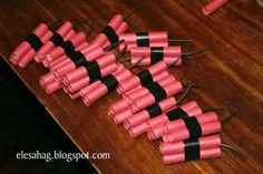 """Roll smarties in red construction paper, then tape 3 together using black electrical tape and stick some black electrical wire in the top for the fuse. Valentine tag can say """"you're a blast"""" or """"you're the bomb"""" or something."""
