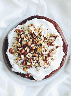 chocolate coffee cake with coconut whipped cream & hazelnuts (sugar, gluten, and dairy free)