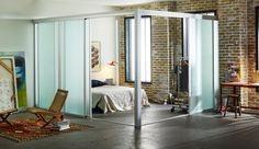 Our sliding glass loft room dividers can be used to create a new bedroom in your loft. See one installed with linen glass and silver frame finish.