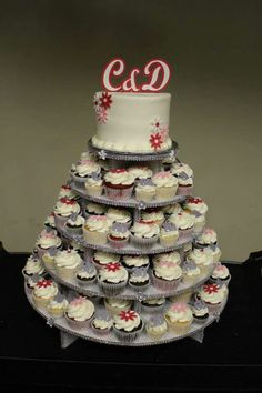 A little bit of bling and fun and whimsy in this cupcake tree. #wedding #weddingcakes #cupcakes